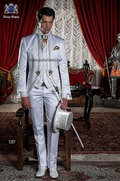 BAROQUE ITALIAN WHITE WEDDING SUIT Model  1287   OTTAVIO NUCCIO GALA Italian bespoke white satin short frock coat with gold floral embroidery and Mao collar, style 1287 Ottavio Nuccio Gala, 2015 Baroque collection.