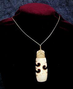 Stunning hei toki and koru spiral / new life bone by carvingbone