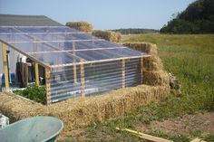 Straw bale Greenhouse..This idea could be incorporated for the fall...If it freezes early in the season..this is a great way to extend those crops you have been nursing all summer.