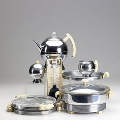 CHASE CHROME AND WHITE BAKELITE; Eight luncheon pieces include hors d'oeuvre pot, coffee pot, creamer and sugar, tidbit tray with glass inserts, serving spatula