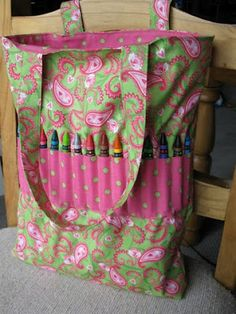 Cute crayon tote.  I would probably move the row of crayons down a bit and make 2 rows.