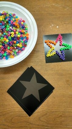 Mosaics with pony beads. Campers obviously filled theirs in better than I did. Many people followed the star pattern but others did their own patterns (pizza and dogs were both popular).