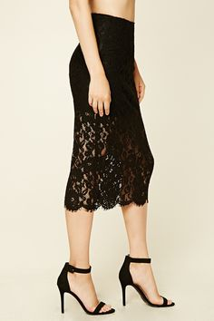 A midi skirt with allover semi-sheer floral lace overlay, a built-in slip, an invisible side zipper, a split-back, and an eyelash lace hem.
