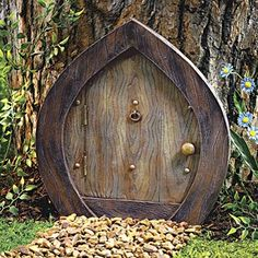 I should buy a gnome door for one of the trees!