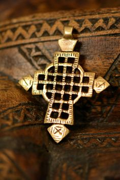 Check out this item in my Etsy shop https://www.etsy.com/listing/277056954/ethiopian-cross-pendant-brass-jewelry