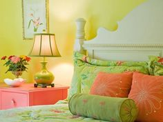 bright & fresh bedroom - medium yellow walls, white trim, white headboard, salmon nightstand, bed linens in white, lime green tones, salmon/apricot tones with pops of yellow, orange, teal