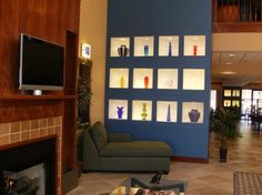 Google Image Result for http://www.orbitz.com/hotelimages/317/259317/2631759-Holiday-Inn-Express-Hotel-Suites-SUFFOLK-Lobby-6.jpg