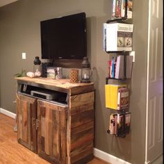 Homemade entertainment center and homemade bookshelf. Pallet wood and industrial pipe.