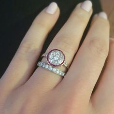 Vintage ruby halo diamond engagement ring with platinum diamond eternity band. Love this combo!