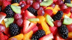Layers of fresh fruit are soaked a citrusy sauce in this colorful salad.