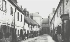 Watford was once a town with one long street and has changed continuously since the Second World War. Watford, Slums, Water Supply, The Other Side, Pavement, Hedges, World War Two, Rooftop, Pond