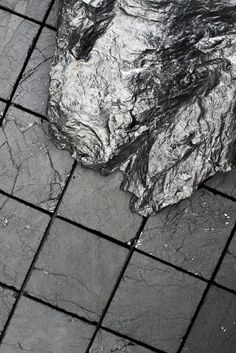 Swedish designer Jesper Eriksson has created an installation consisting of flooring, furniture and other objects made from solid coal. 'Coal: Post-Fuel' explores an idealized future. Color Inspiration, Interior Inspiration, Industrial, Coal Mining, In The Flesh, Landscape Design, Britain, Marble, Grey