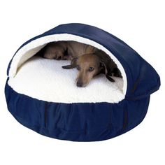 Pet bed with faux lambswool lining and cedar fill.   Product: Pet bedConstruction Material: Polyester cotton and...