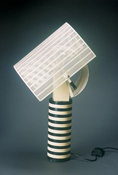 Description : SHOGUN is a table lamp designed by Mario Botta for Artemide. This lamp whose structure is in black and white painted metal provides an ultra contemporary touch to your interior. The diffusers are painted perforated sheet steel. The superposition and orientation of the diffusers... #DeskLamp, #TableLamp #Botta, #Conceptual, #Design, #Shogun, #Vintage @idlights