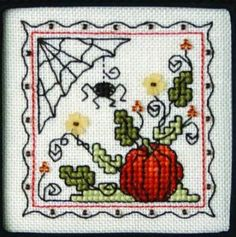 Teenie Tiny Halloween I with charms is the title of this cross stitch pattern from The Sweetheart Tree.