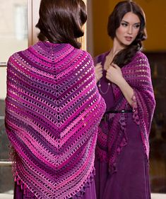 This gorgeous shawl combines a beautiful design with wonderful shaded yarn. Crochet it starting at the center top and work your way to down to the lacy scalloped edge.
