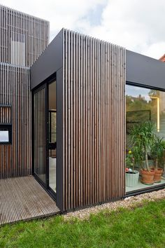 of Wooden frame house / a + samuel delmas - 13 Wooden frame house / a + samuel delmas, I like the concept and use of available space.Wooden frame house / a + samuel delmas, I like the concept and use of available space. House Cladding, Timber Cladding, Exterior Cladding, Cladding Ideas, Rainscreen Cladding, Aluminium Cladding, Timber Slats, House Facades, Wooden Slats