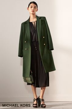You can't make a serious impact without a statement coat. The opulence of this moss green hue makes this coat a flawless choice for fall. –xxMK   Paired back to feminine favorites—think softly pleated skirts and tie-neck blouses—a coat that makes an impact adds just the right touch of structure for fall and beyond.   Click to shop statement coats.