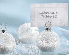 """The """"Snow Flurry"""" Holiday Ornament Place Card and Photo Holder is a snow-lover's delight inside and out, making it the perfect favor for your winter wedding or holiday party."""