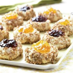 Thumbprint Cookies Recipes | These cookies have a bit of crunch from the finely chopped pecans, sweetness from the almond extract, and richness from the butter. | SouthernLiving.com