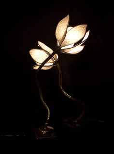 Owen Commons Metal Furniture & Sculpture: two lamps made from recycled metal, found objects and handmade paper.
