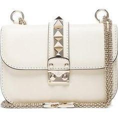 Alessandra Ambrosio wearing Valentino Small Lock Flap Bag.