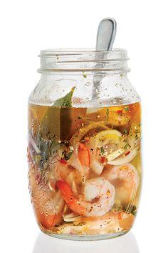 Pickled Shrimp by Saveur. Briny, faintly spicy pickled shrimp are a staple of Southern cuisine. In this Georgia-inspired version from from Hugh Acheson's A New Turn in the South (Clarkson Potter, frozen raw shrimp are a fine substitute for fresh. Pickled Shrimp Recipe, Shrimp Recipes, Spicy Pickled Eggs, Seafood Dishes, Fish And Seafood, Think Food, Ceviche, Fermented Foods, Canning Recipes