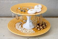 Get rid of tiny jewelry box. Hang necklaces, bracelets, earrings. Use pretty tiered tray for what remains