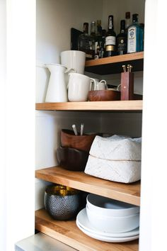 Have Ikea Countertops cut at your local lumberyard to fashion chunky, exposed-wood shelving. open shelves, ikea countertop