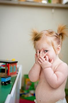 There is nothing cuter than naked babies with pig tails playing peek a boo. Nothing.