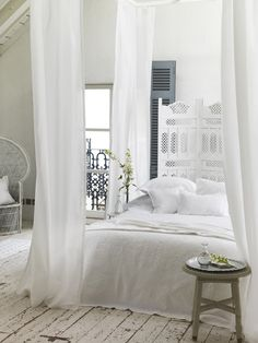 lovely ethereal and romantic white bedroom with quirky and unique elements... & love the drapey canopy bed from the sheers... Sarah Kaye ...
