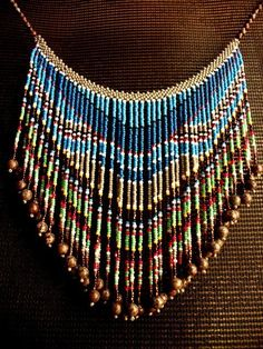 Beaded Bib Necklace Hand Beaded Bib Necklace - -Hand Beaded Bib Necklace - - A very tiny wall hanging for a very tiny wall. Glass & Stone Beaded Bib Tassel Necklace for Women in Seed Bead Necklace, Seed Bead Jewelry, Beaded Jewelry, Beaded Necklace, Glass Necklace, Fringe Necklace, Stone Jewelry, Seed Beads, Gold Necklace