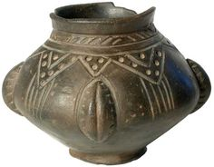 A Saxon blackware pottery urn with everted neck and pedestal base, the shoulder decorated with geometric panels of stamped ornament, the body with four solid bosses and groups of incised vertical lines, short section of rim lacking, 6th century A.D., 4.5in high, 6.25in diameter.