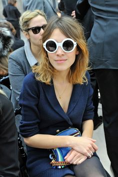 Alexa Chung in white sunnies.