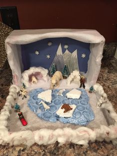 Polar bear habitat project...sugar cube igloo. Bubble painted for the water. Styrofoam ice blocks. Bear den made from clay and covered with fake snow