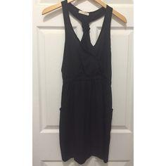 Lush Brand Black Surplice Dress - Never Worn Black Surplice dress from Lush. Never worn. Excellent condition. Tie detail on racerback. Pockets at sides. Elastic waist. 100% polyester. Size Medium. Lush Dresses Mini