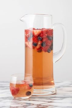 Strawberries, raspberries, and blueberries meet rosé in this crisper, totally refreshing alternative to classic red sangria. Get the recipe: Triple Berry Sangria Watermelon Sangria, Sangria Drink, Berry Sangria, Rose Sangria, Wine Cocktails, Cocktail Drinks, Party Drinks Alcohol, Fruit Drinks, Alcoholic Beverages