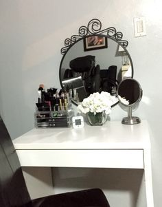 $107.00 Complete make up vanity for small spaces and small budgets. IKEA>Vanity is an small computer desk (Micke-$52.50) w drawer, mirror (Ekne-$15.75) and small digital clock (Clocke-$5.25). Walmart>Vase with flowers ($3.00 Vase, $3.00 flowers, $10.00 small mirror). Amazon>Acrylic make up organizer $17.50.