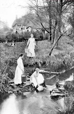 Women drawing water from a stream.  Life was harder then!
