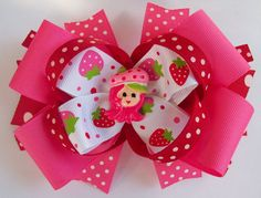 Oh so Berry, Berry Cute ! Everyones favorite little Strawberry girl. I can make a custom made hair bow just for you. This bow is  $8.00. http://www.etsy.com/shop/JustinesBoutique