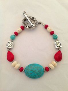 Red, cream and turquoise bracelet on Etsy, $14.00