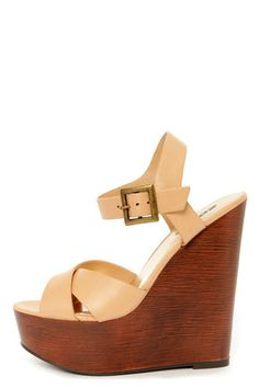 Check it out from Lulus.com! Raise your look to greater heights of hotness with the Soda Lofty Natural Beige Platform Wedge Sandals! Creamy beige vegan leather is lightly burnished for a natural look, with a crisscrossing, open toe vamp, and classic quarter strap that fastens with a burnished brass buckle (and hidden elastic). 1.75