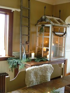 mini conservatory made out of windows and used inside as a display case