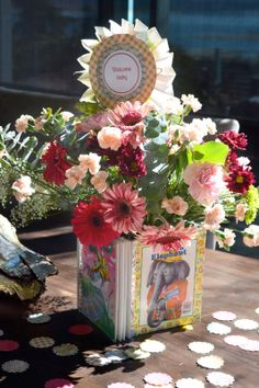 Flowers in a vase made of vintage Golden Books - so easy and cute for a baby shower