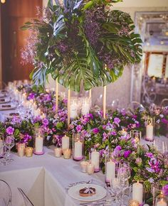 Purple with concentrated greenery #outdoorwedding #candles