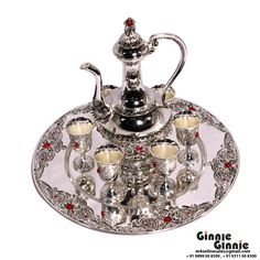 This Ginnie & Ginnie Exclusive Wine Set With aftab is a product from our Bar Accessories Collection. It is made of Alloy and it got Silver Lacquer Coating finish on it. Its approx LxWxH is 12x12x10 inches. It is of approx 1370 grams. Unique Code of this product is M400393.12