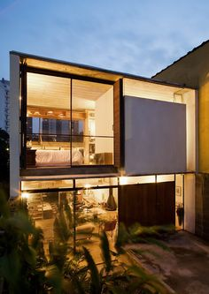 The idea was to make this three storey house as transparent as possible, in a way that would establish a visual relationship between external and internal areas. To make this viable, the openings were designed at the rear and front of the structure to be three metres wide and to be on the same axis. When open, large glazing elements slide along the walls uniting the external and internal spaces.    Architecture: Apiacas Arquitetos