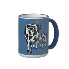 Cute Cow Cartoon Mug - black and white mother cow and her calf nursing against a deep blue background