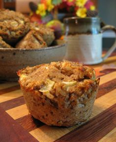 "Apple muffins: 2 cups applesauce  4 eggs  ½ cup blanched almond flour or almond meal  1/3 cup coconut flour, sifted  1/3 cup finely chopped walnuts  1/3 cup finely chopped pecans  ½ cup shredded coconut  2/3 cups sliced almonds  1 tsp cinnamon  ½ tsp nutmeg  ¼ tsp cloves  ¼ tsp salt  ½ tsp baking soda  1 fresh cooking apple, cut into small ¼"" pieces (you could also substitute raisins)"