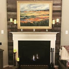Fireplace facelifts are one of our favorite projects! Our reclaimed wood planks add so much interest & character to this family room & really play up the colors in the painting 🖼️ What's your fa Cozy Fireplace, Wood Planks, Small Spaces, Family Room, Play, Colors, Projects, Painting, Character